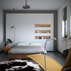 Organic meets industrial- bedroom with monochrome cowhide rug storage niches and earthy styling