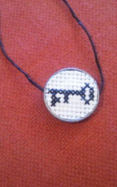 Key Cross Stitched Necklace Good idea for mini cross stitches. Tiniest thing I've ever seen.. :P
