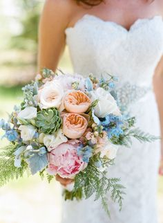 Beautiful blooms - love the mix of peonies, garden roses and succulents!   Read more - http://www.stylemepretty.com/wyoming-weddings/jackson-hole/2014/01/16/jackson-hole-wedding-at-hotel-terra/
