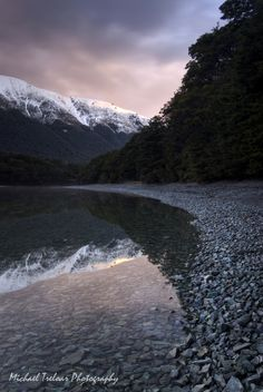 Mavora Magic - Mavora Lakes, South Island, New Zealand. Sunset.    A lost wilderness off the main road to Te Anau.     A snow storm had just blown over and dusted the mountains in fresh snow. A clear patch in the weather and the sun came out for sunset.