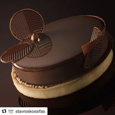 #Repost @stavroskossifas what's better than an authentic gianduja????? almond sort crust ganache with patisfrance gianduja36% and milk chocolate thin chocolate layer chocolate moist sponge cake mousse gianduja chocolate milk glaze #bakelikeaproyoutube #chocolat #cake #chocolatecake #gateau #gateauchocolat #entremet