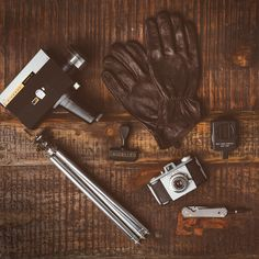 Things Neatly Organized. Flat Lay Photography. Vintage Camera, Super 8 Film, Leather Gloves, Compass, Knife. @filsonco