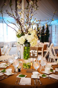 High center piece with branches and greenery