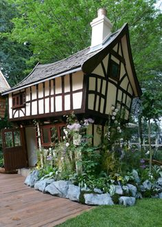 Can you imagine having a playhouse like this as a kid?!  Impressive!