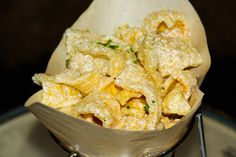 Get your snack on at Queue Bar, Book & Stage or Vesper and enjoy housemade Chicharones.