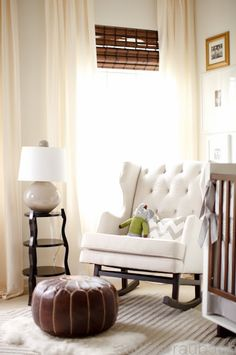 Hello best nursery chair I've ever seen. Also love the roman shades with the soft curtains hung all the way to the ceiling. Perfect.