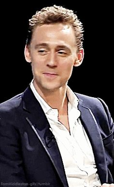Tom Hiddleston - Is he chewing on his lip?!?!? *faints*