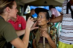 U.S. Navy Lt. Stephanie Ellis, left, examines a Filipino woman during a cooperative health event in Victory Village, Legazpi, Albay province, Philippines, Oct. 1, 2013. The event is part of Amphibious Landing Exercise 14. Ellis, a family practitioner, is assigned to Marine Corps 3rd Medical Battalion. U.S. Marine Corps photo by Lance Cpl. Katelyn Hunter