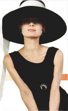 The drama of the over-sized hat with the slim body, the sense of mystery when we're unable to see the whole of her face. The only feature sits on her slim waist and the colours are classics.