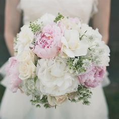 ...a fluffy mix of ivory hydrangeas, Queen Anne's lace, wax flowers, white roses, pink peonies and gardenias.