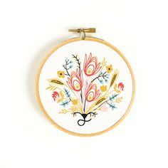 This ready-to-hang embroidered art hoop adds country charm to a gallery wall. A Christmas must-have!