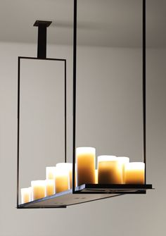 Kevin Reilly Lighting... but if I would use a: - water pipes tube for structure;  - led strip for light; - cheap coloured glasses for candles illusion? ... :)