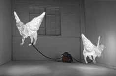 "Martha Pels, ""To Fly, To Drive"" (2009–11), cast epoxy resin and fiberglass, fluorescent lights, 1997 V8 Lincoln Engine, plastic chains, and steel cable"