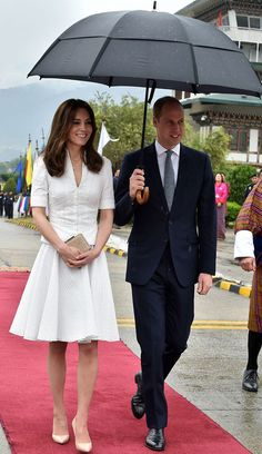 From Berkshire to Buckingham : Kate Recycles White McQueen for Bhutan Departure