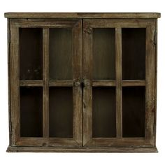 Wood wall cabinet with two doors and distressed finish.   Product: CabinetConstruction Material: Wood and glass