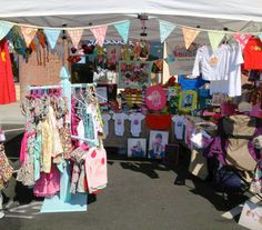 Build a hanging clothes rack from a fence post for craft fairs