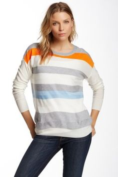 Love the interesting colors of the stripes on this sweater for an easy work day attire