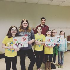 """Last night Sergeant Nazzaro gave a talk about drug and alcohol resistance to Girl Scout Troop 40093 at the Community Center so they can receive their Municipal Alliance badge. Here they are displaying their """"21 means 21"""" posters."""