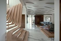 Arquitectura en Movimiento Workshop have designed a two-storey apartment for a family in Mumbai, India.