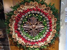 Medallion based, rich colored wreath for many seasons.  Cooperstown N Y