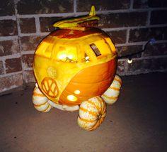 Halloween Pumpkin Carving Idea: Pumpkin Volkswagen Bus with Mini Pumpkin Tires and a Roof Rack holding a Squash Surfboard