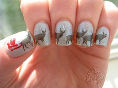Pretty amazing nail art - reindeer with sled and Rudolph at the helm!
