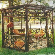 wood gazebo Magnolia Pearl Ranch  with iron bed headboard gate