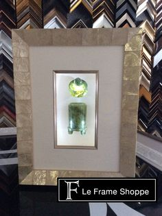 Custom framed with this gorgeous mother of pearl frame, this ornate jade bottle is showcased perfectly. Notice the wow factor with the custom lighting to bring this masterpiece to the next level!