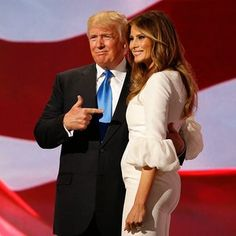 Donald Trump escorts his wife Melania after her speech during the second session in the Quicken Loans Arena.
