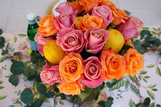 Mother's Day Table Setting Idea with sunset roses, leopard napkins, gold chargers