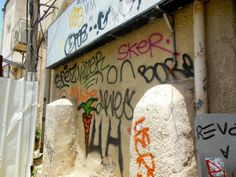 Carrot graffiti near juice stall on the border of Florentine and Neve Tzadek districts of Tel Aviv. Friday 20 June 2014