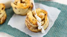 Easy, peasy! Turn cinnamon rolls into sweet flowers with just a few simple steps.
