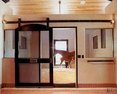 I keep saying I want to do open doors like this.  It would be cool in the summer.   Stall & Oats Blog from Lucas Equine Equipment: Horse Stall Design