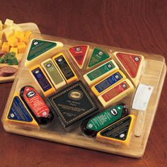 Buy The Ultimate Gourmet Cutting Board. More - The Ultimate Gourmet Cutting Board. The Ultimate Gourmet Cutting BoardServe up our handsome wooden cutting board topped with delicious gourmet goodies and we guarantee the snacking won't end anytime soon! Cheese Gift Baskets, Cheese Gifts, Gourmet Gift Baskets, Gourmet Gifts, Food Gifts, Gourmet Cheese, Meat And Cheese, Cheese Spread, Cheese Trays