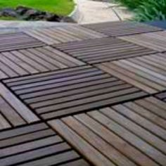 Wood decking idea for roof terrace. From http://wooddeckingtile.files.wordpress.com/2009/01/teak-wooden-floor-tiles.jpg?w=500