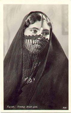 VEILED......NATIVE EGYPTIAN WOMAN..........ON GRUMPY OLD FART....