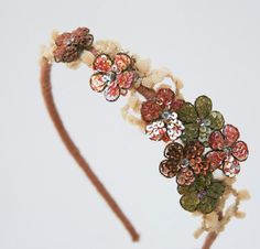 spring flower headband of vintage lace and beaded flowers, via Etsy.