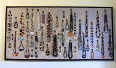 Turn an ugly bulletin board into a beautiful way to display jewelry! Brilliant! www.BeadphoriaBlog.com
