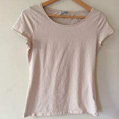 H&M Basic Nude Tee High quality Pima cotton and a great color make this top a basic necessity. Worn and washed once. Great as a bundle add-on! No trades. Offers welcome. Take 30% off your entire purchase automatically at checkout when you use the bundle feature. I am also happy to create a special bundle for you. Happy Poshing!  H&M Tops Tees - Short Sleeve