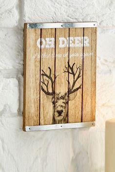 Oh Deer Wooden Picture - £7 Wooden sign with metal edging. Sign reads 'Oh Deer, it's that time of year again'. Includes wire hook for hanging. Measures H20 x L15cm
