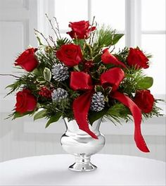 Beautiful Christmas arrangements | Christmas Flower Arrangement | The Florister