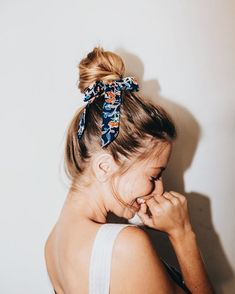 bun with colored fabric hair tie or hair scarf