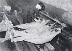 An air raid warden checks on children sleeping on hammocks strung between the train tracks in a London Underground station during the Blitz Picture: Rex Features London History, British History, World History, Uk History, Primary History, London Underground Stations, The Blitz, U Bahn, Air Raid