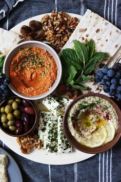 Grilled Mezze Platter appetizer - with marinated herbed feta, fresh herbs like mint or dill, lavash, olives, grapes and dried figs. Aperitivos Vegan, Aperitivos Finger Food, Fingers Food, Good Food, Yummy Food, Cooking Recipes, Healthy Recipes, Yummy Recipes, Food Platters