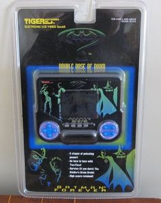 "This is the Batman Forever Electronic LCD video game, titled ""Double Dose of Doom"". Made by Tiger Electronics in 1995 for the Batman Forever movie toy line."