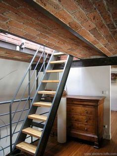 loft stairs ideas | 24. Spiral staircase in black metal in a loft.