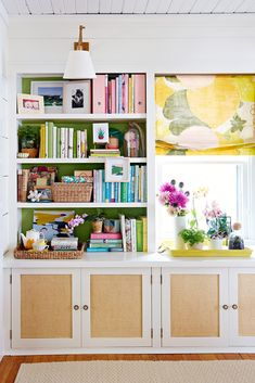 Open shelves aren't just a pretty spot to display books and collectibles; they can also ensure often-used items are easy to access. Line up identical baskets on a shelf to organize reading materials, TV remotes, and other small items. #storage #basketstorageideas #office #shelforganization #bhg White Bookshelves, Decorating Bookshelves, Bookcases, Wood Shelving Units, Wood Shelves, Corner Shelves, Open Shelves, Floating Shelves, Bookcase Makeover