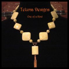 http://www.sellergroup.com/shop/TelumaDesigns  Lime Jasper Retro Inspired necklace with Gold metal chain tassel. Fun, funky and eye catching, great for Summer or brighten up a Winder outfit. Handmade OOAK exclusive to Teluma Designs. (Code 290N)