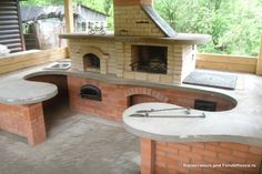 nice outdoor kitchen with a wood fired pizza oven