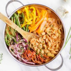A vegan one pot pasta shown with colorful veggies.